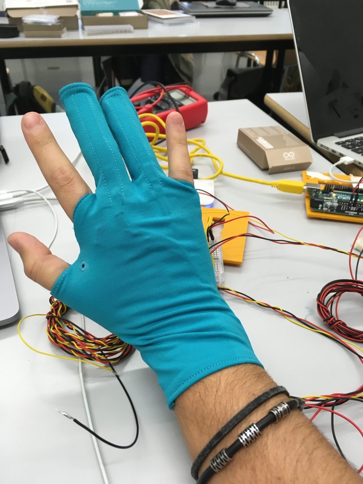 Testing the cables inside the gloves
